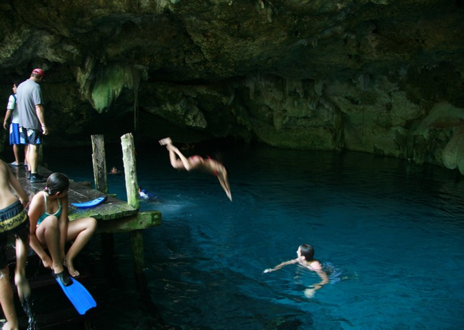 Children diving Dos Ojos Cenote, Tulum, Mexico